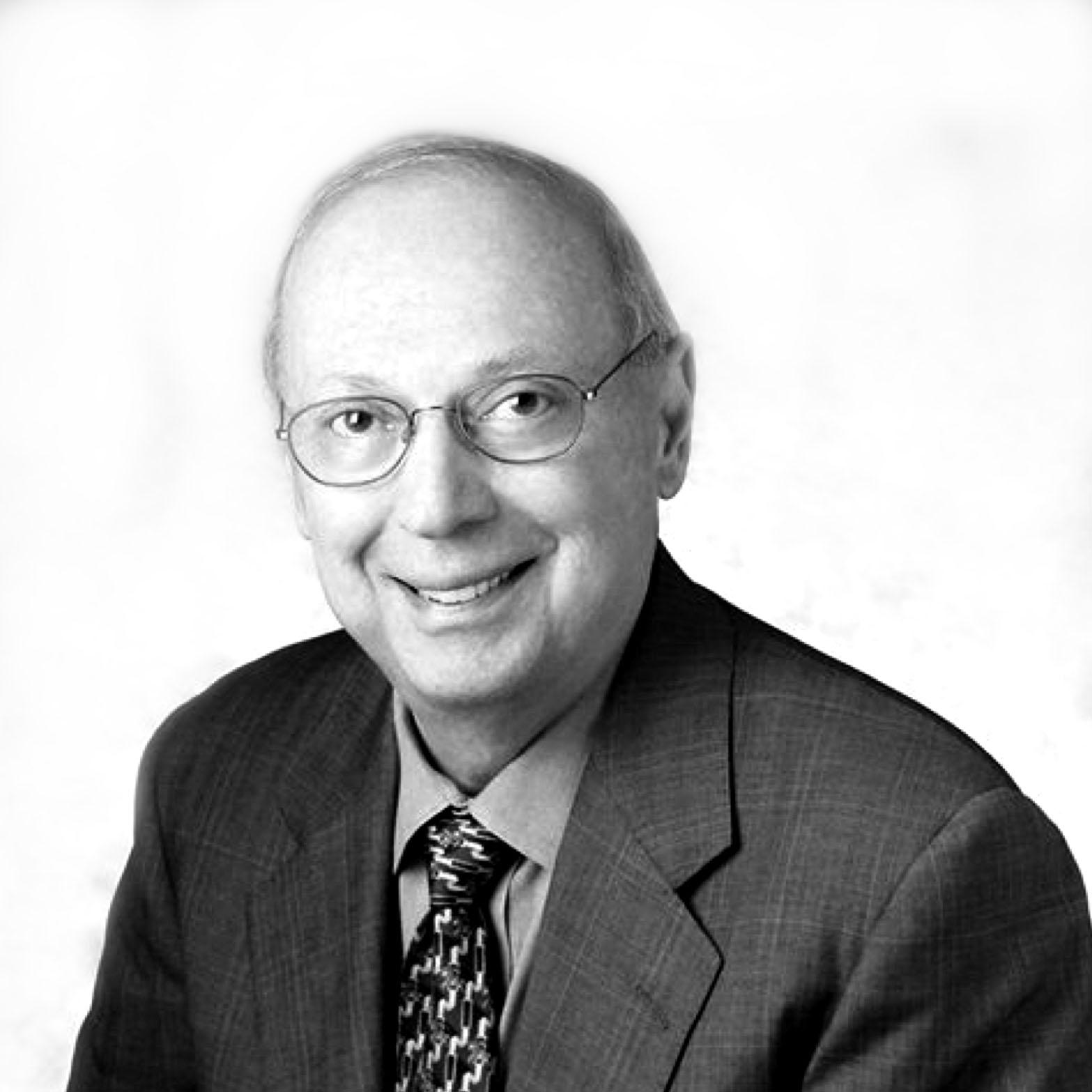 ROBERT E. EVANSON